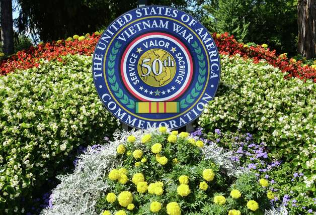 The Saratoga Springs Vietnam War 50th Anniversary Commemorative Committee's floral display created by the city's Public Works Department in Congress Park Friday, Aug. 29, 2014, in Saratoga Springs, N.Y.  (John Carl D'Annibale / Times Union) Photo: John Carl D'Annibale / 00028342A