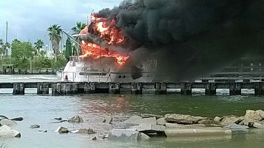Three passengers on a 52-foot yacht escaped to safety after their vessel caught fire under the Kemah bridge on Friday, Aug. 29, 2014. | Outriggers Seafood Restaurant Photo: Outriggers Seafood Restaurant