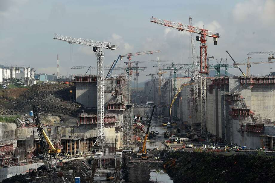 View of the Panama Canal locks under construction in Cocoli, near Panama City, on August 8, 2014. Next August 15 marks the 100th anniversary of the Panama Canal, considered to be one of the 20th century's marvels of engineering and through which goes five percent of the maritime world trade. Panama took control of the 80-km-long canal and the 1,426-square-km enclave that surrounds it at midnight on December 31, 1999 according to the 1977 handover treaty signed by then-presidents of the US, Jimmy Carter and Panama, Omar Torrijos.   AFP PHOTO/ Rodrigo ARANGUARODRIGO ARANGUA/AFP/Getty Images Photo: Rodrigo Arangua, AFP/Getty Images