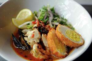 The seafood ramen, above, and the tandoori zataar chicken, below, are entrees at Ruggles Black.