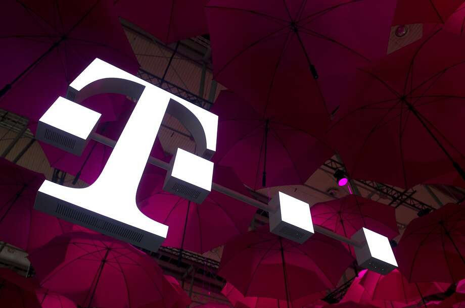 With Sprint out of the running, Deutsche Telecom will entertain bids for T-Mobile. Photo: John Macdougall, AFP/Getty Images