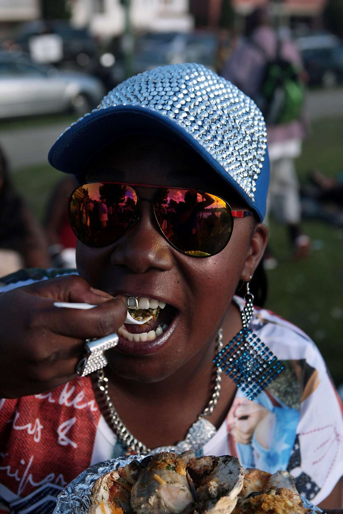 Dorian Monroe takes a bite of a seasoned barbecued oyster at a