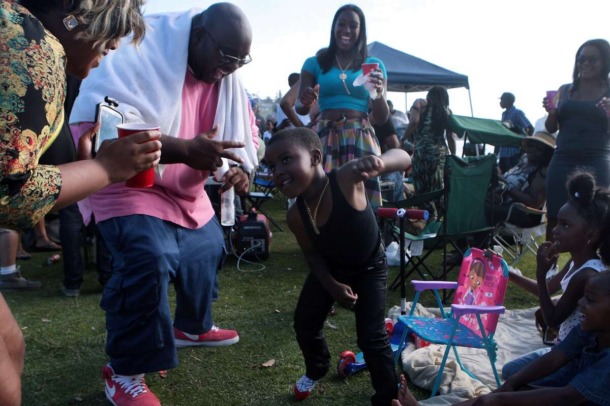 Lamont Green, 5, dances to the delight of many at a
