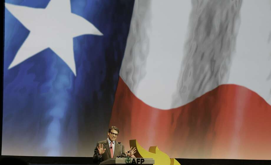 Texas Gov. Rick Perry speaks at the gathering of the Americans for Prosperity group in Dallas. Photo: LM Otero, Associated Press