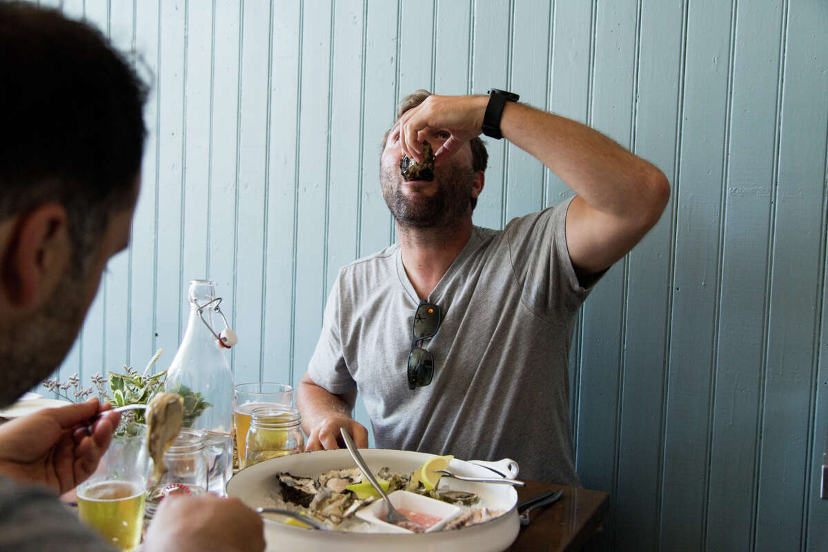 Diners dig into an array of oysters at a new neighborhood spot, Red Hill Station in San Francisco's Bernal Heights. The city has long offered a few venerable oyster houses, and there's new enthusiasm for the onetime staple.