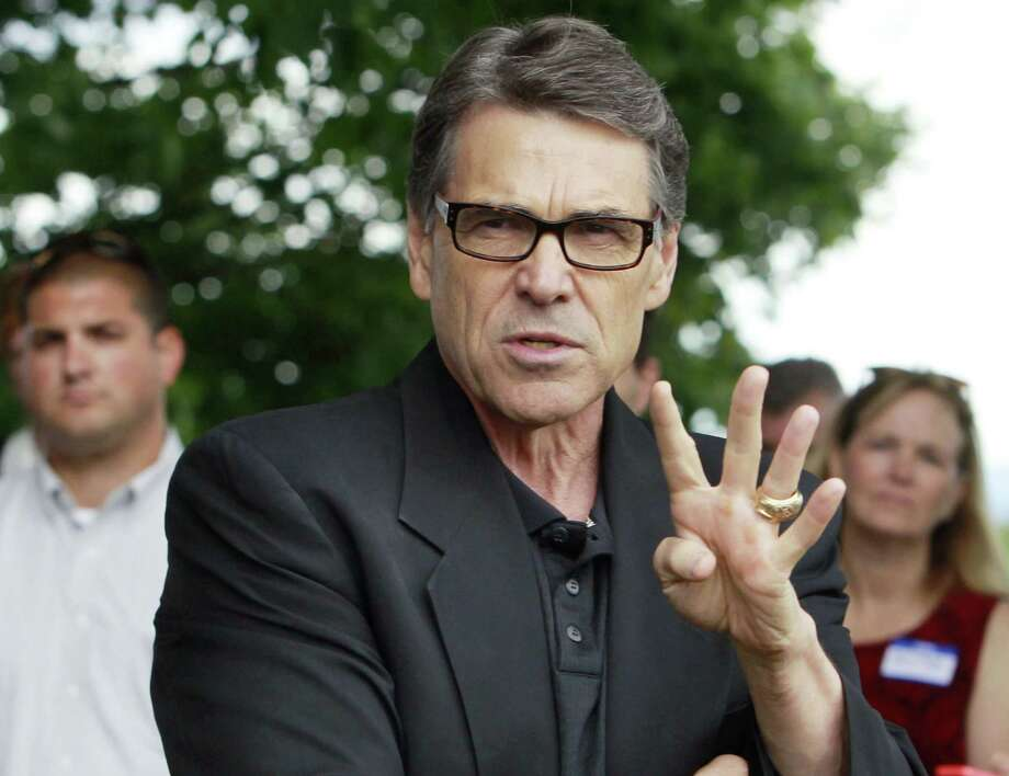 Readers continue to weigh in on the indictment against Gov. Rick Perry, shown here speaking at a GOP picnic in Chichester, N.H. Photo: Jim Cole / Associated Press / AP