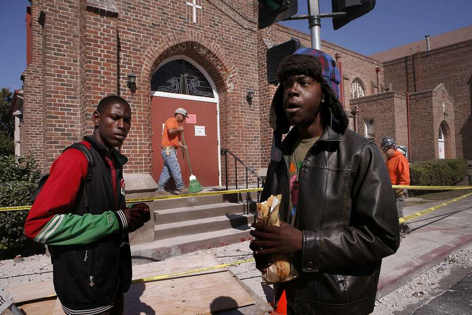 Jordan Scott (left) and Herbert Bell accept food from the Salvation Army at Vallejo's First Baptist Church. Photo: Michael Macor, The Chronicle