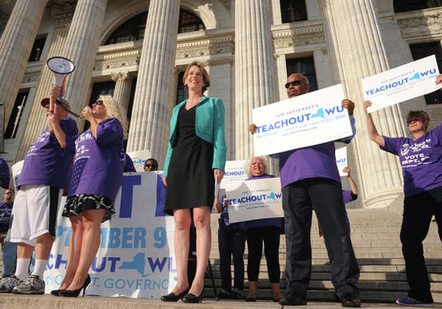 Democratic candidate for New York Governor Zephyr Teachout, center, makes a campaign stop at the State Education Building on Thursday Aug. 28, 2014 in Albany, N.Y.  (Michael P. Farrell/Times Union) Photo: Michael P. Farrell, Albany Times Union / 00028380A
