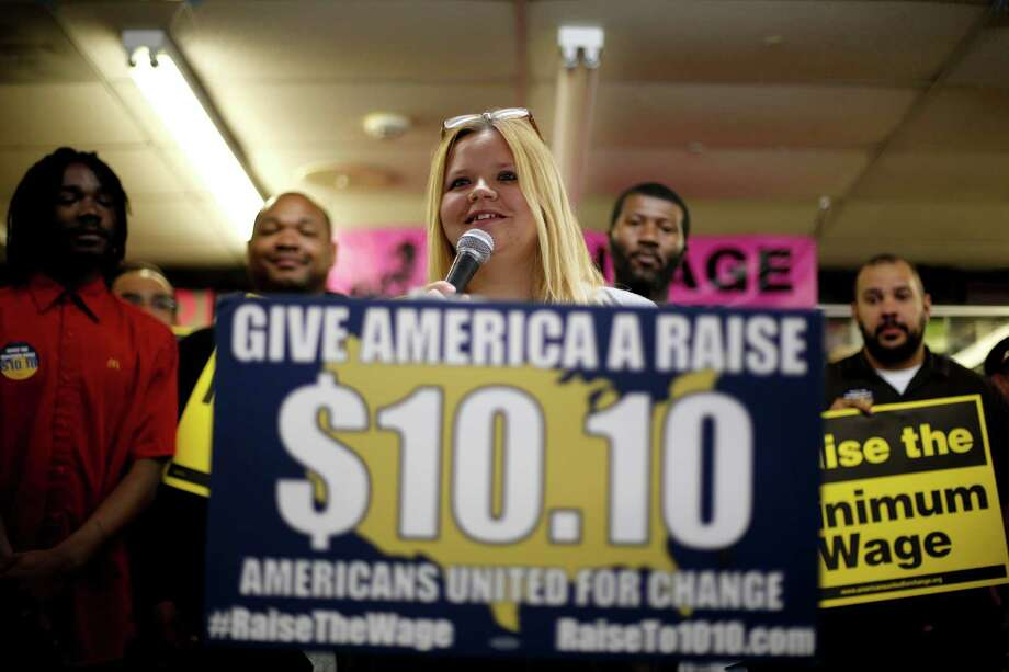 Raising the minimum wage would be a step toward reducing the wealth gap. Photo: Jeff Roberson, Associated Press / AP