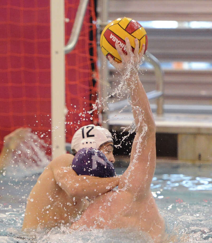Brunswick's Pat Stefanou (# 12)  defends a shot by a Gonzaga College High School player during the 39th Annual Cardinal Water Polo Tournament at Greenwich High School, Saturday, Oct. 19, 2013. Photo: Bob Luckey / Greenwich Time