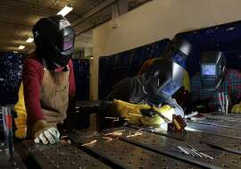 Welding instructor Rebecca Chapman, left, watches as her student Esther Cervantes practices a weld during a class at the TechShop in San Francisco, Calif., on Monday, February 7, 2011. The TechShop is a cross between High School shop class and high tech factory. Membership in the workshop allows access to light and heavy machinery and tools. Members, range from hobbyists to entrepreneurs, creating everything from t-shirts to light fixtures, to prototypes to motorcycles.
