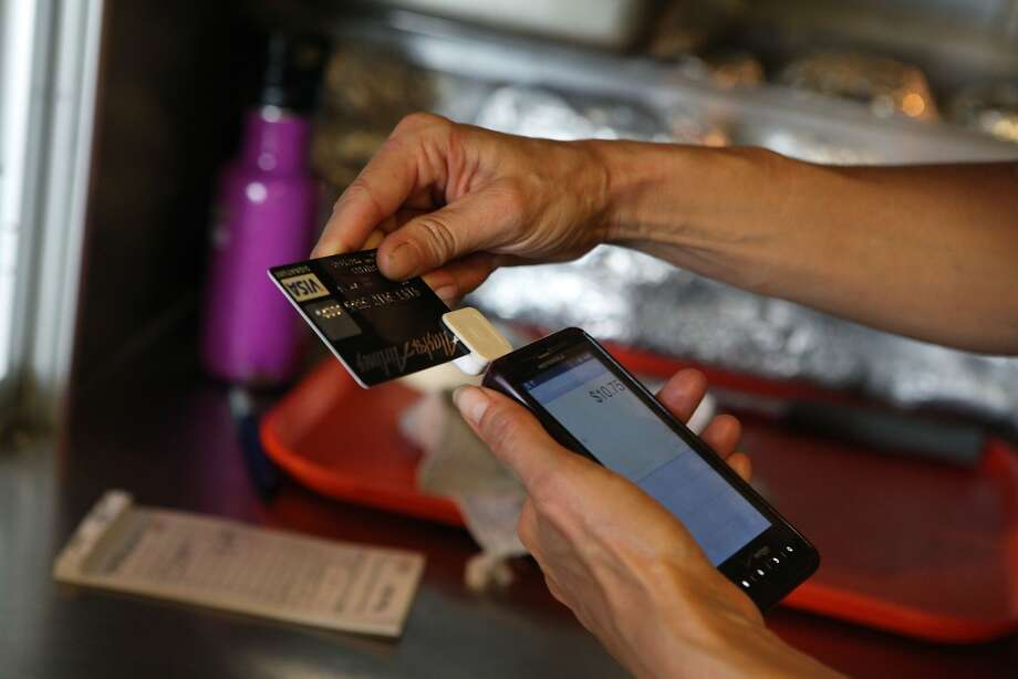 Credit and debit cards have grown in popularity, as have card devices from companies like Square. Photo: Audrey Whitmeyer-Weathers, Special To The Chronicle