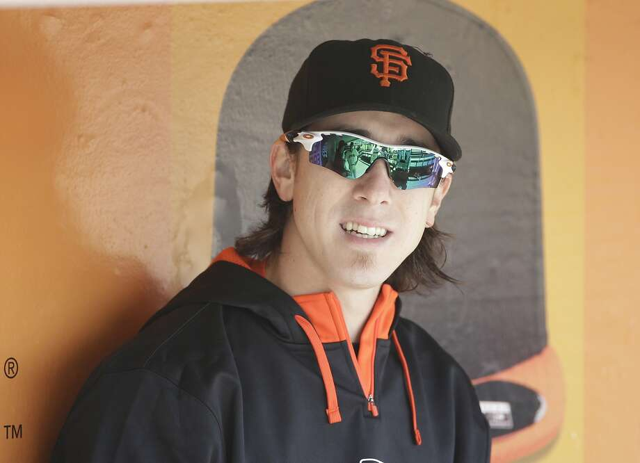 San Francisco Giants pitcher Tim Lincecum sits in the dugout before the start of their game against the Colorado Rockies Thursday, Aug. 28, 2014, in San Francisco. Lincecum was to have been the starting pitcher, but was sent to the dugout earlier in the week. (AP Photo/Eric Risberg) Photo: Eric Risberg, Associated Press