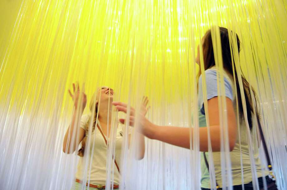 "Rice University students Hanah Millimet and Morgan McNeel explore  the Soto intstallation ""The Houston Penetrable"" at the Museum of Fine Arts Houston. Monday will be the last day to experience the exhibit. Photo: Dave Rossman, Freelance / © 2014 Dave Rossman"