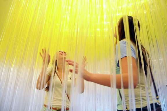 """Rice University students Hanah Millimet and Morgan McNeel explore  the Soto intstallation """"The Houston Penetrable"""" at the Museum of Fine Arts Houston. Monday will be the last day to experience the exhibit."""