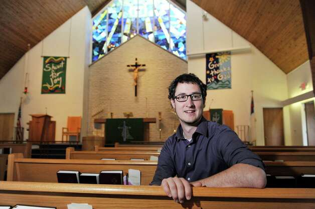 Assistant pastor at  Delmar Lutheran Church, Josh Krepel, poses for a photograph in the sanctuary on Wednesday, Aug. 27, 2014, in Bethlehem, N.Y.    (Paul Buckowski / Times Union) Photo: Paul Buckowski / 00028351A