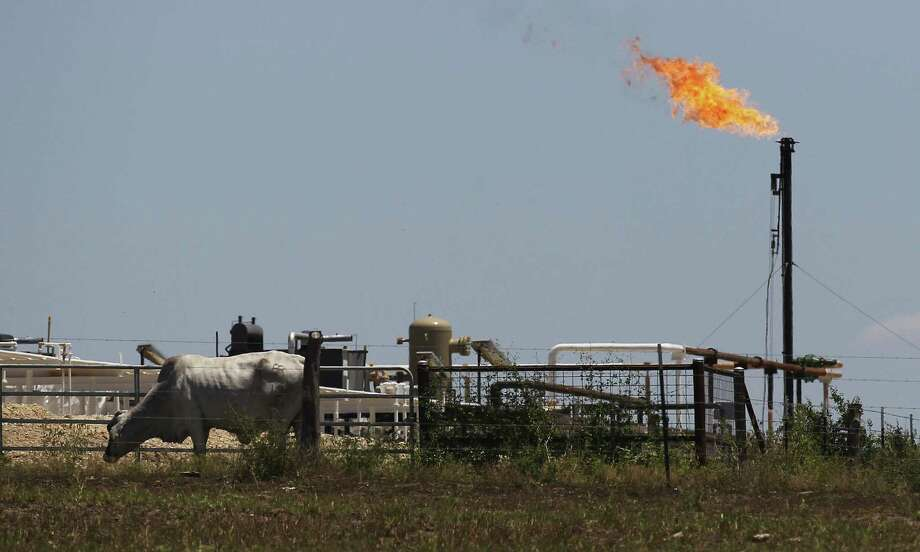 A flare burns on FM 81 near Karnes City, Texas on Thursday, May 15, 2014. Photo: Kin Man Hui, San Antonio Express-News / ©2014 San Antonio Express-News