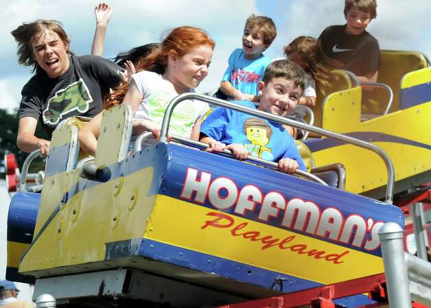 Children and their families scream as they round a curve on the roller coaster on Friday, Aug. 29, 2014, at Hoffman's Playland in Latham N.Y. (Cindy Schultz / Times Union) Photo: Cindy Schultz / 10028400A