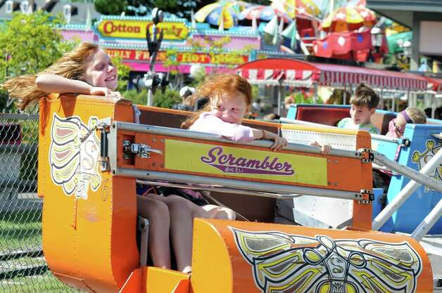 Adeline Hubbell, 9, of Albany, left, and her sister Ella Hubbell, 11, take a spin on the Scrambler on Friday, Aug. 29, 2014, at Hoffman's Playland in Latham N.Y. (Cindy Schultz / Times Union) Photo: Cindy Schultz / 10028400A