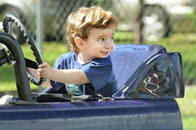 Tyler Tice, 2, of Guilderland takes the wheel on a car ride on Friday, Aug. 29, 2014, at Hoffman's Playland in Latham N.Y. (Cindy Schultz / Times Union) Photo: Cindy Schultz / 10028400A
