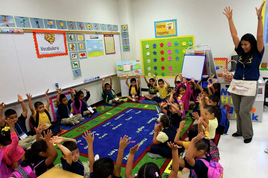 Bilingual kindergarten teacher Maria Cortez interacts with her students during the first day of school at Thurgood Marshall Elementary, Monday, Aug. 26, 2013, in Houston. (Cody Duty / Houston Chronicle) Photo: Cody Duty, Staff / © 2013 Houston Chronicle