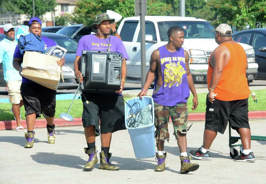 From left, Aaron Perrault, Jeffery Whittacker and Everett Warick help incoming freshman move into the dorms at Lamar University on Friday.  Photo taken Friday, August 21, 2014 Guiseppe Barranco/@spotnewsshooter Photo: Guiseppe Barranco, Photo Editor