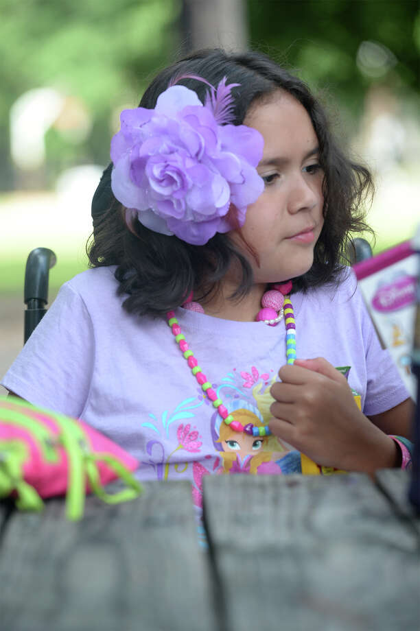 Ali Najera, 9, of Jasper colors at the park. Najera has received more than 1,000 birthday cards after her parents posted her story online. Photo taken Thursday, August 21, 2014 Guiseppe Barranco/@spotnewsshooter Photo: Guiseppe Barranco, Photo Editor