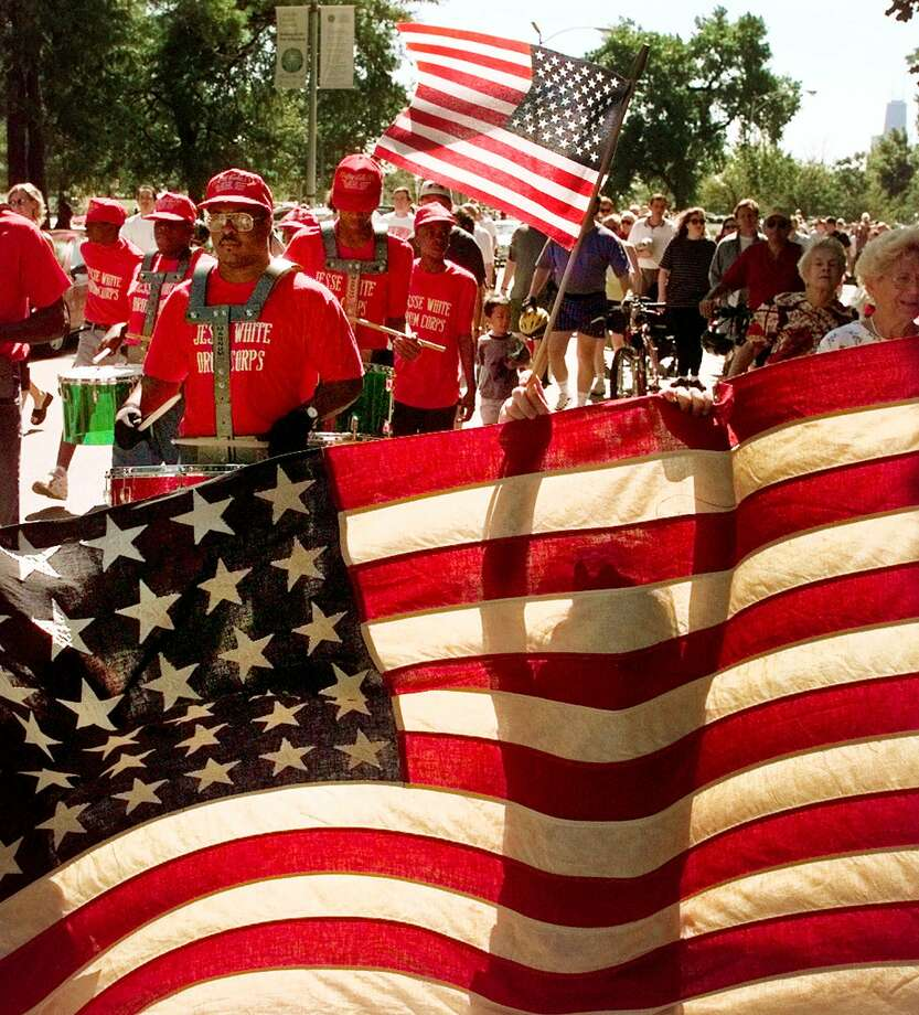 Diana Crispin, 6, is silhouetted as she helps carry Old Glory, Monday, Sept. 6, 1999, during the 36th annual Wellington-Oakdale Old Glory Marching Society (WOOGMS) Labor Day Parade in Chicago. Photo: TED S WARREN, STF / AP