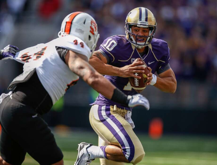 QuarterbacksPetersen and the Huskies got an unwelcome distraction when redshirt sophomore Cyler Miles, the team's presumed starter at quarterback, was involved in an alleged assault the night of Super Bowl XLVIII along with receiver Damore'ea Stringfellow. Miles (above) was suspended for spring football, but Petersen ultimately reinstated him after it was revealed he wouldn't face charges from the incident.Petersen did ban Miles for the season opener at Hawaii, which fellow sophomore Jeff Lindquist will start after beating out redshirt freshman Troy Williams for the job. After the opener, Miles is expected to win back the starting role, though Lindquist and Williams could also see action.Miles is the only one with game experience, completing 37 of 61 pass attempts last season for 418 yards, four touchdowns and two interceptions in relief of Keith Price. All three quarterbacks were highly touted coming out of high school, and Petersen — an accomplished developer of quarterbacks — should be able to turn a perceived weakness into a strength sooner than later. Photo: Otto Greule Jr, Getty Images