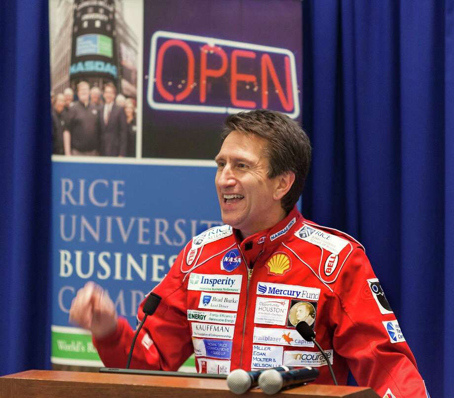 Rice University/Jones School of Business/McNair Hall. Story on the annual Rice Business Plan Competition.  ID: Sporting dozens (and dozens!) of company logos from event supporters on a racecar-style jumpsuit, the Managing Director of the Rice Alliance Brad Burke addresses the crowd before the elevator pitch competition.  Thursday  4/11/13 (Craig H. Hartley/For the Chronicle) Photo: Craig Hartley, Freelance / Copyright: Craig H. Hartley