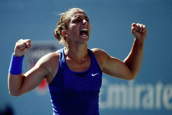 Sara Errani soaks in the moment after outlasting Venus Williams in their third-round match Friday.