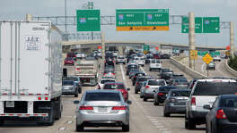 Drivers make their way along 610 near I-10, Thursday, Aug. 28, 2014, in Houston. Loop 610 between Interstate 10 and U.S. 59 west of downtown Houston is the most congested segment of highway in the state, according to the newest ranking by the Texas Department of Transportation. Analysts estimate drivers waste 1.18 million hours annually by idling and slowly moving along the highway because of traffic. (Cody Duty / Houston Chronicle)