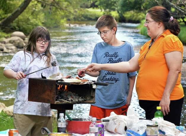 The Diamond family, from left, Amanda, 11, Wyatt, 13, and Kim Diamond of Watervliet, enjoy an end of summer cookout and picnic on the banks of Geyser Brook at Saratoga Spa State Park Friday Aug. 29, 2014, in Saratoga Springs, N.Y.  (John Carl D'Annibale / Times Union) Photo: John Carl D'Annibale