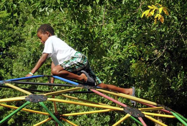 Eight-year-old Quace Kimble of Troy plays on a geodesic playground climber at Frear Park on Friday, Aug. 29, 2014, in Troy, N.Y. (Michael P. Farrell/Times Union) Photo: Michael P. Farrell