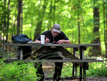Derek Renninger, of Bethel, spends some time studying the Bible at one of the picnic benches at Overlook Park in Bethel, Conn. Friday, Aug. 29, 2014.