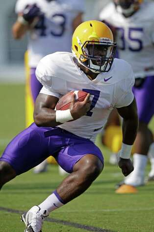 FILE - In this Aug. 6, 2014, file photo, LSU freshman running back Leonard Fournette (7) runs through drills during an NCAA college football practice in Baton Rouge, La. Fournette headlines another promising group looking to make an immediate impact.  (AP Photo/Gerald Herbert, File) ORG XMIT: NY177 Photo: Gerald Herbert / AP
