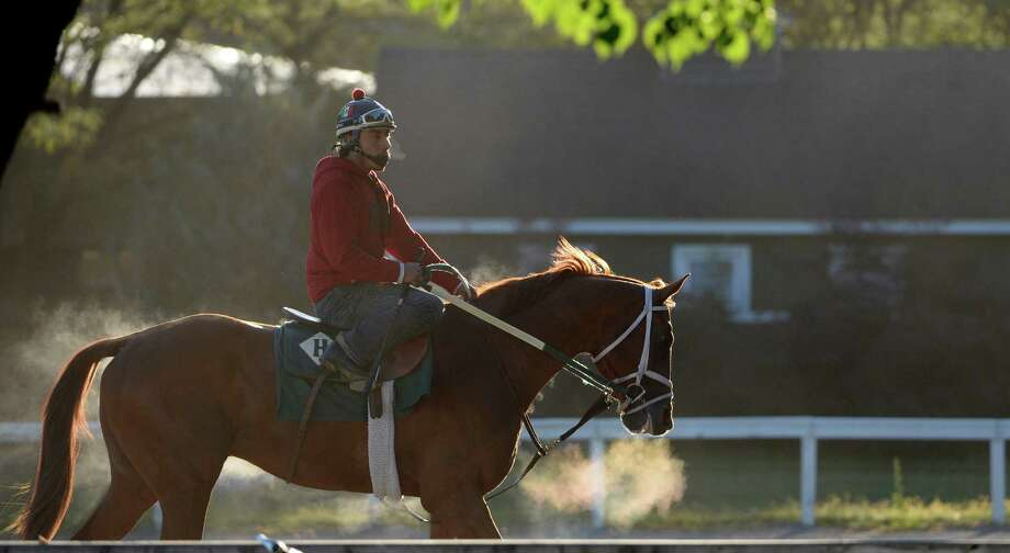 Steam from the horse and rider caused by a unseasonably cool morning Aug. 29, 2014 at the Saratoga Race Course in Saratoga Springs, N.Y.     (Skip Dickstein/Times Union) Photo: SKIP DICKSTEIN
