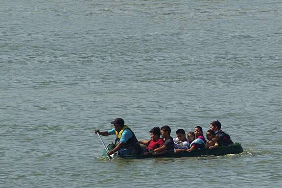 A group of seven people are smuggled from Mexico across the Rio Grande River near Mission in May. The group from El Salvador and Honduras included two mothers each with a child, and an 11-year-old boy and two 17-year-olds who said they were heading to Houston and Maryland.