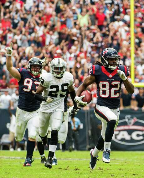 Wide receiver Keshawn Martin, right, had some success returning kickoffs and punts for the Texans last season and will get another chance when the regular season begins Sept. 7. Photo: Smiley N. Pool, Staff / © 2013  Houston Chronicle