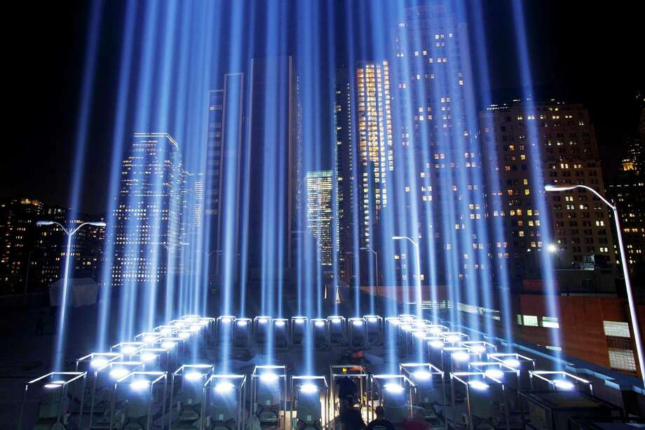 FILE- In this Sept. 10, 2013 file photo, the Tribute in Light rises above buildings during a test in New York. While the plaza at the National September 11 Memorial and Museum will be closed to the public, during the September 11 commemoration ceremony and much of the rest of the day, it will be open from 6 p.m. to midnight for those who want to pay respects and view one of the anniversary's most evocative traditions, the twin beams called the Tribute in Light. (AP Photo/Mark Lennihan, File) ORG XMIT: NYR301 Photo: Mark Lennihan / AP