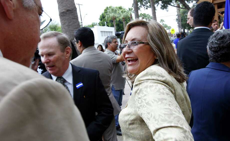 Consul Sandra Agreda greets guests at the opening of the El Salvador Consulate in McAllen. El Salvador also has consulates in Houston and Dallas. Photo: Nathan Lambrecht / The (McAllen) Monitor / The Monitor