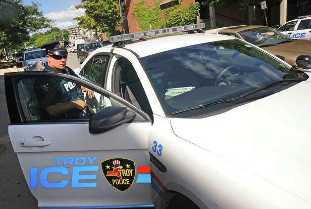 Troy Police Officer William Gladys gets ready for his shift at Troy Police headquarters on Friday Aug. 29, 2014 in Troy, N.Y. Troy police announced Friday they are putting another 20 officers on the street in the wake of recent violence.(Michael P. Farrell/Times Union) Photo: Michael P. Farrell / 10028399A