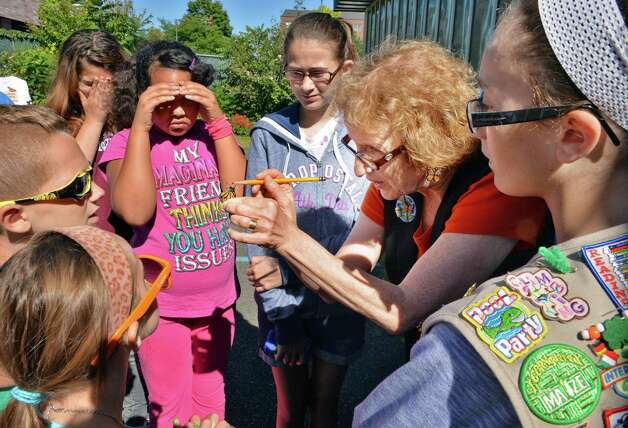 Carol Ann Margolis, center, education coordinator of the Albany Heritage Area Visitors Center, teaches Girl Scouts how to tag Monarch butterflies at the Girl Scouts of Northeastern New York Service Center Friday, Aug. 29, 2014, in Colonie, N.Y.  (John Carl D'Annibale / Times Union) Photo: John Carl D'Annibale / 00028327A