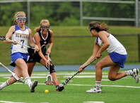 Newtown's Anna Northrop, left, New Fairfield's Casey Jagemann, center, and Newtown's Riley Wurtz compete for the loose ball during their Division I SWC championship game at Newtown High School on Friday, May 25, 2012. Newtown won 18-13.