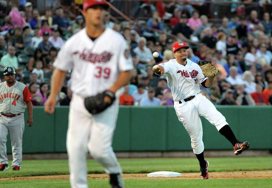 ValleyCats' third baseman Nick Tanielu, right, fires the ball to first during their baseball game against the Brooklyn Cyclones on Friday, Aug. 29, 2014, at Bruno Stadium in Troy, N.Y. (Cindy Schultz / Times Union) Photo: Cindy Schultz / 00028317A