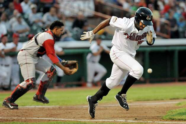 ValleyCats' Jose Solano, right, sprints for first as Cyclones' catcher Adrian Abreu chases down the ball during their baseball game against the Brooklyn Cyclones on Friday, Aug. 29, 2014, at Bruno Stadium in Troy, N.Y. (Cindy Schultz / Times Union) Photo: Cindy Schultz / 00028317A