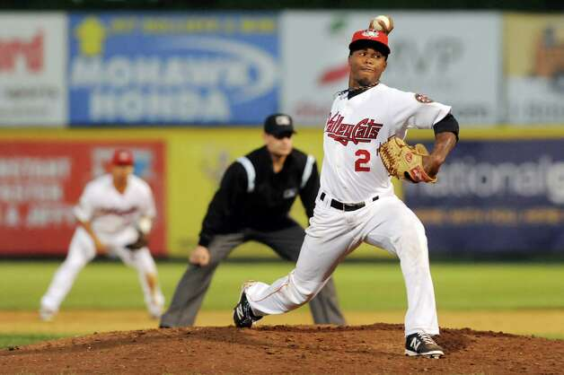 ValleyCats' Angel Heredia, right, winds up the pitch during their baseball game against the Brooklyn Cyclones on Friday, Aug. 29, 2014, at Bruno Stadium in Troy, N.Y. (Cindy Schultz / Times Union) Photo: Cindy Schultz / 00028317A