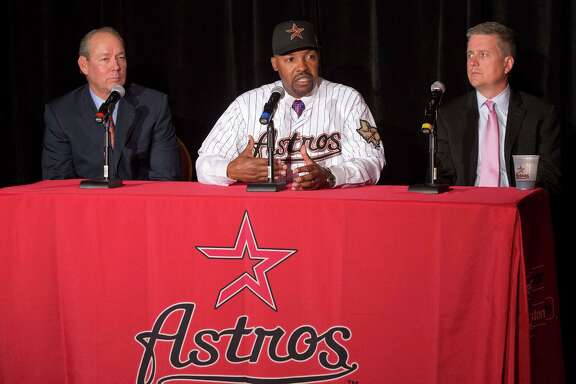 Back in possibly happier times, newly hired manager Bo Porter is sandwiched between Astros owner Jim Crane, left, and general manager Jeff Luhnow. Porter denied Friday he has talked to Crane about reported troubles with Luhnow.