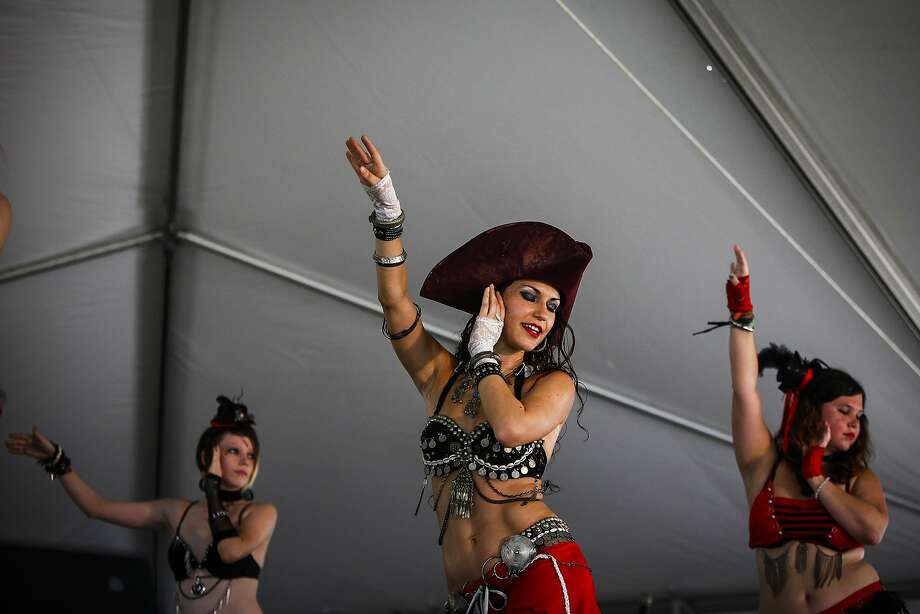 Shake, ripple and roll: Belly dancing instructor Amber Lea (center) performs alongside her 