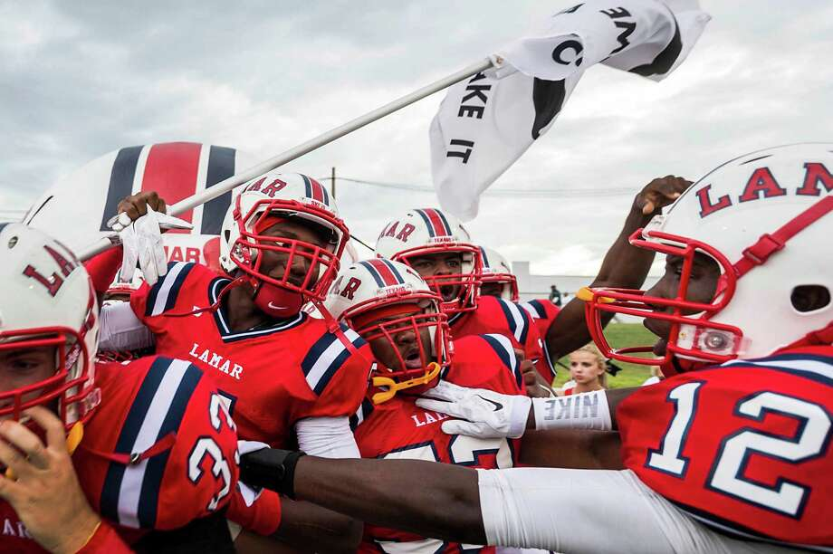 Lamar players take the field to face Brenham in their first high school football game of the season at  Delmar Stadium, Friday, Aug. 29, 2014, in Houston. Photo: Smiley N. Pool, Houston Chronicle / © 2014  Houston Chronicle